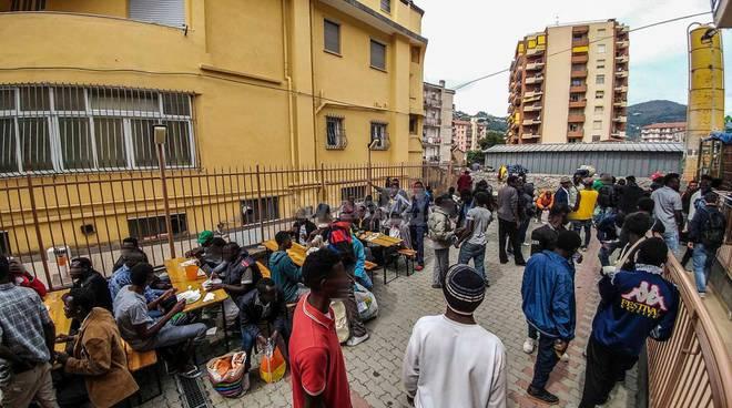 migranti caritas