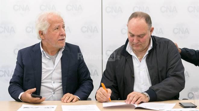Riviera24-La firma della convenzione tra i due presidenti unogas cna lagorio matteucci