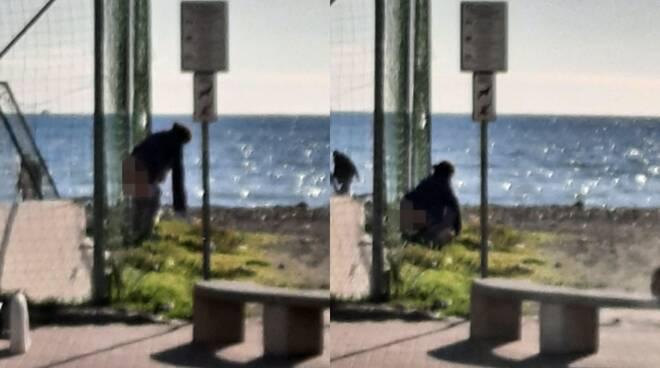 donna defeca spiaggia ventimiglia